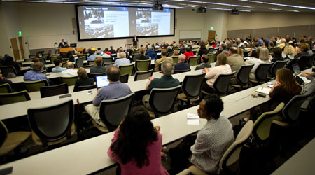 A speaker at the front of a georgia tech classroom